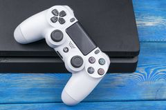 Sony PlayStation 4 Slim 1Tb revision and dualshock game controller. Game console with a joystick. Home video game console Royalty Free Stock Images
