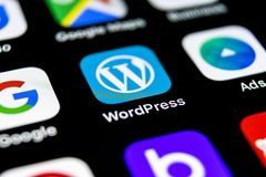 Wordpress application icon on Apple iPhone X screen close-up. Wordpress app icon. Wordpress.com application. Social network stock photography