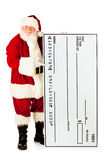 Sankt: Santa Claus Holding Oversized Check Stockfotos