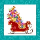 Sankt-Schlitten mit bunten Geschenken Stockbild