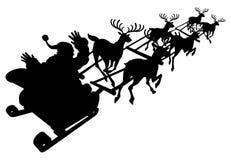Sankt in seinem Weihnachtsschlitten- oder -Pferdeschlittenschattenbild Lizenzfreie Stockbilder