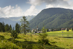 Sankt Ulrich am Pillersee with Jakobskreuz on the Buchensteinwand summit. In Kitzbuhel Alps Stock Photo