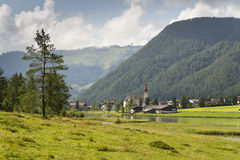 Sankt Ulrich am Pillersee with Jakobskreuz on the Buchensteinwand summit. In Kitzbuhel Alps Stock Image