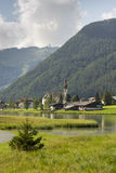 Sankt Ulrich am Pillersee with Jakobskreuz on the Buchensteinwand summit. In Kitzbuhel Alps Royalty Free Stock Photo