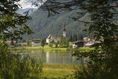 Sankt Ulrich am Pillersee with Jakobskreuz on the Buchensteinwand summit. In Kitzbuhel Alps Royalty Free Stock Image