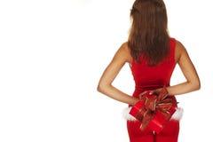 Sanktdame, die ein Geschenk anhält Stockbild
