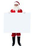 Sanktt Nicholas som plattforer bak blank whiteboard Royaltyfria Bilder