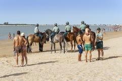 Sanlucar Beach Horse Races. Sanlucar De Barrameda Beach Horse Racing 8th August 2013, Cadiz Province, Andalusia, Spain: The mounted section of the Guarda Civil Stock Image