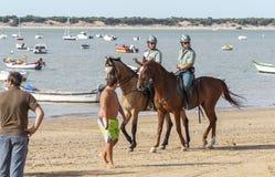 Sanlucar Beach Horse Races. Sanlucar De Barrameda Beach Horse Racing 8th August 2013, Cadiz Province, Andalusia, Spain: The mounted section of the Guarda Civil Stock Photos