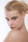 Sanny32. Beauty portrait of a girl with a make-up in gold and green tones Stock Photo