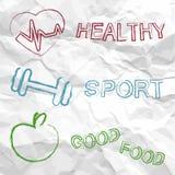 Sano, deporte, comida en un papel arrugado Imagen de archivo