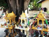 Sanprapums - houses for spirits. Very important part of a Thai religion. People leave some water and food for spirits to honour their memory and pray for alive royalty free stock image