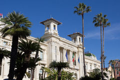 Sanremo Casino view - Historic Liberty building of Ligurian Riviera. Sanremo, Italy - February 05, 2016: Palm trees in front of the Casino Municipale facade Stock Photography