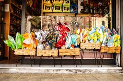 Sanremo, Italy, April 2019: traditional chocolate Easter eggs decorate a storefront. stock images