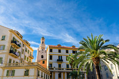 Sanremo (Italy). Buildings and a palm Stock Photos