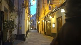 A narrow pedestrian street with in the old european town. SANREMO, ITALY - MARCH 29, 2018: A narrow pedestrian street in the old town of Sanremo late at night stock video footage