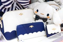 Sanrio Japan merchandises on display in Sanrio area. Cinnamoroll is a famous Sanrio character. Selective on the navy blue wallet. Bangkok, Thailand - June 16 royalty free stock images