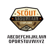 Sanserif font and scout patch Royalty Free Stock Photography