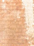 Sanskrit etched into sandstone Stock Image