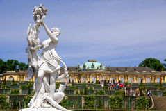 Sanssouci castle. Marble statue with Sanssouci castle in the background in Potsdam, Germany Stock Photography