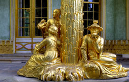 Sanssouci royal park in Potsdam. The gilded sculpture at the roof of the Chinese house in the sanssouci royal park in Potsdam in Germany Royalty Free Stock Image