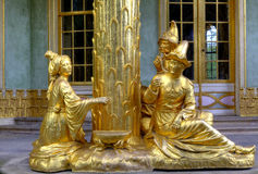 Sanssouci royal park in Potsdam. The gilded sculpture at the roof of the Chinese house in the sanssouci royal park in Potsdam in Germany Royalty Free Stock Images