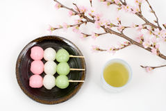 Sansyoku-dango and cherry blossoms. Japanese three colors rice dough dumplings named Sansyoku-dango(or Hanami-dango Stock Photos