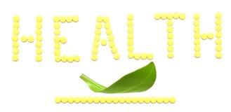 SANTÉ de mot effectuée à partir des pillules jaunes de médicament Photo libre de droits