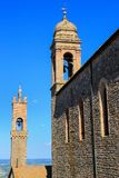 Sant`Agostino Church and bell tower of Palazzo dei Priori in Mon. Talcino town, Val d`Orcia, Tuscany, Italy. The church and adjacent convent were erected by the Stock Image