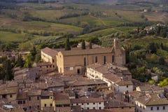 Sant ` Agostino kościół z krajobrazem San Gimignano, widzieć od Zdjęcia Royalty Free