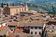 Sant Agostino kyrka och hustak på San Gimignano Royaltyfria Foton