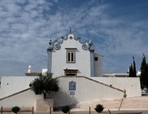 Sant`ana Church Albufeira Portugal. Igreja or church of Sana`ana Albufeira Portugal against a blue and cloudy sky Royalty Free Stock Images