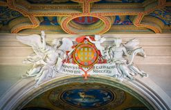 Cardinal Nuno da Cunha coat of arms supported by angels Basilica of Sant`Anastasia near the Palatine in Rome, Italy. royalty free stock photo