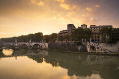 Sant angel bridge and tevere at sunrise. The river Tevere and one of the beautiful bridges you could find in Rome Stock Photos