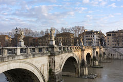 Sant Angelo bridge over the Tiber river, Rome, Italy, buildings, Royalty Free Stock Images