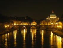 sant-angelo-bridge-and-san-pietro-basilica-at-night Royalty Free Stock Images