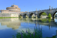 Sant Angelo castle and bridge over Tevere river, Rome. Sant Angelo castle reflecting on river Tevere, in Rome Stock Photos