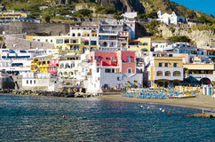 Sant`angelo on Ischia Island, tourist destination in the Gulf of Naples, Italy. Ischia, Italy - April, 2017: tourist harbor with typical Mediterranean boats in Stock Photography