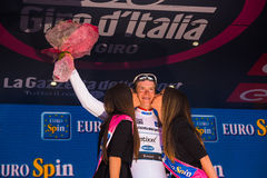 Sant Anna, Italy May 28, 2016; Bob Jungels, Etixx Quick Step Team, in white jersey on the podium after winning the classification Royalty Free Stock Photography