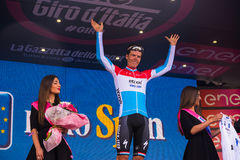 Sant Anna, Italy May 28, 2016; Bob Jungels, Etixx Quick Step Team, in white jersey on the podium after winning the classification. Young riders in the Tour of Royalty Free Stock Image