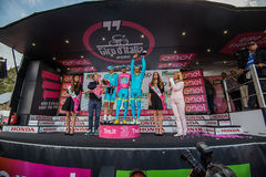 Sant Anna, Italy May 28, 2016; Some Riders of Astana team  on the podium after winning the award for best team Stock Photo