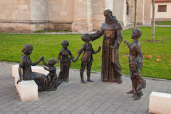 Sant Antonio statuary ensemble in Alba Iulia. A statuary ensemble depicting Sant Antonio of Padova (Saint Anthony of Padua) taking care of the children, in the royalty free stock image