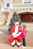 Sant Claus And Girl Looking At Each Other Stock Images