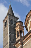 Sant eustorgio tower, milano. Detail of tower and pinnacles of ancient church, shot in bright autumnal light Stock Photo