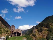 Sant Joan de Caselles (Andorra), romanesque church. Sant Joan de Caselles (Andorra) - Exterior of the old church in Romanesque style, in a landscape of mountains Stock Image
