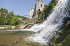 Sant Joan les Fonts,Catalonia,Spain. Village view, ancient water mill, moli fondo, and waterfall, Sant Joan les Fonts, Garrotxa, province Girona, Catalonia royalty free stock photos