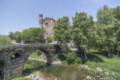 Sant Joan les Fonts,Catalonia,Spain. Village view, medieval bridge over river and tower church, Sant Joan les Fonts, Garrotxa, province Girona, Catalonia Royalty Free Stock Image