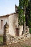 Sant Miquel del Castell chapel with cypress trees. Sant Miquel del Castell or Capella del Remei is the Romanesque chapel of the Castle of Sant Miquel, or Xetmar royalty free stock photography