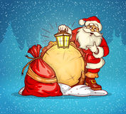 Santa �laus with lantern and sack of gifts Royalty Free Stock Photos