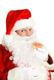 Santa łasowania bożych narodzeń ciastko Fotografia Stock